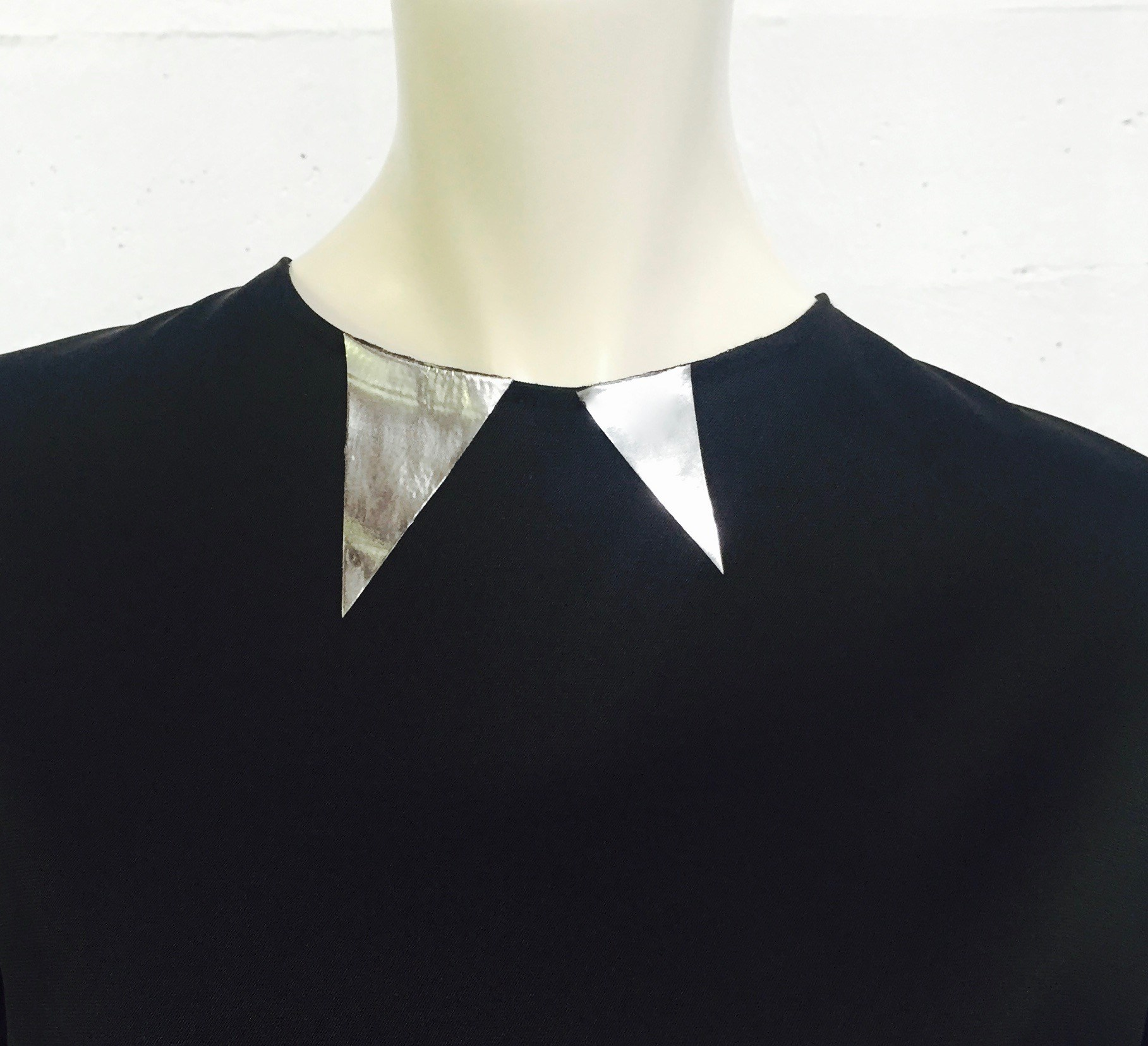 "Our signature 'fang"" neckline detail"